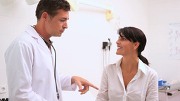 Doctor holding a stethoscope with a patient Stock Video Footage