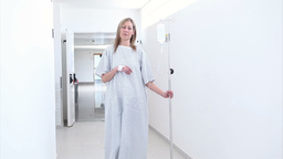 Patient walking in the corridor with an intravenou Stock Video Footage