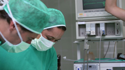 Serious doctors operating a patient Stock Video Footage