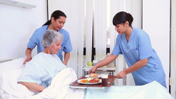 Nurse bringing food to a senior patient Stock Video Footage