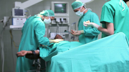 Doctors working on patient with tensiometer Stock Video Footage