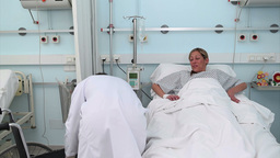 Doctor assisting a patient in a wheelchair Footage