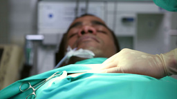 Unconscious male patient on an operating table Footage