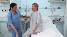 Nurse assisting a patient to lie down in a medical Stock Video Footage