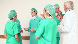 Surgery team speaking to each other Footage