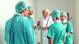 Surgery team speaking to each other Stock Video Footage