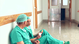 Surgeons talking next to a doctor Stock Video Footage