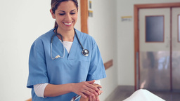 Nurse holding hand of a female patient Stock Video Footage