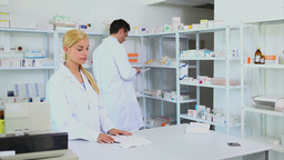 Someone giving a prescription to a pharmacist Stock Video Footage