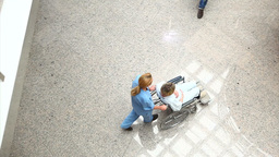 High angle view of a medical team wheeling a patie Footage