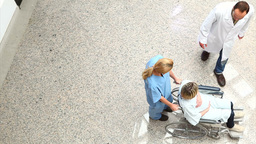 High angle view of a nurse wheeling a patient in a Footage