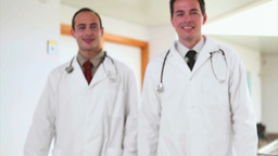 Two smiling doctors walking Footage