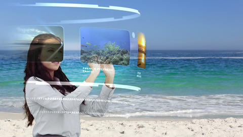 Woman looking at holiday activities on interactive Footage