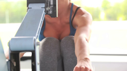 Woman training on a rowing machine Stock Video Footage