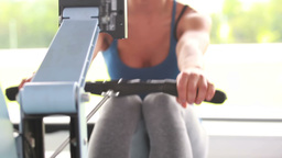 Woman training on a rowing machine Footage