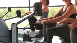 Women working out on rowing machine Footage