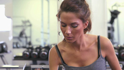 Woman lifiting a dumbbell Stock Video Footage