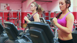 Two women running on treadmill Footage