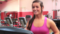 Smiling woman on treadmill Footage