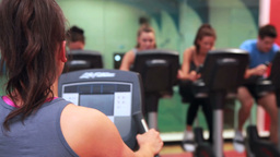 Woman teaching spinning class Stock Video Footage