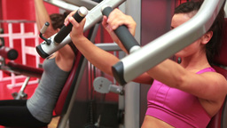 Women using weights machines Footage