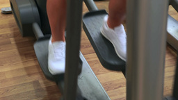 Woman using cross trainer Footage