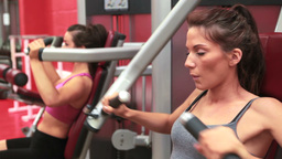 Women training on weights machine Footage