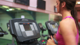 Woman running on treadmill in gym Stock Video Footage