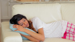Woman sleeping on the couch Live Action