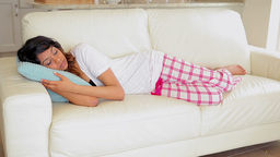 Woman lying on the couch sleeping Live Action