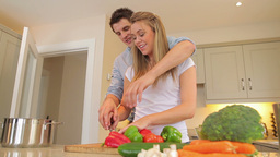 Couple cutting vegetables together Stock Video Footage
