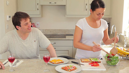 Woman preparing sandwches for lunch with husband Stock Video Footage