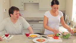 Woman preparing sandwches for lunch with husband Footage