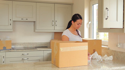 Woman packing up boxes and man moving them Stock Video Footage