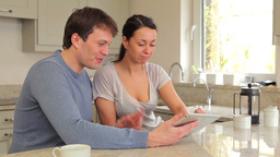Couple using tablet pc together Stock Video Footage