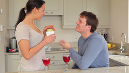 Couple drinking red wine with husband presenting g Stock Video Footage