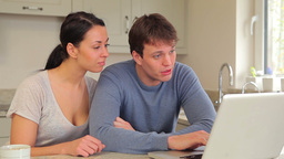Couple talking and looking at laptop Footage