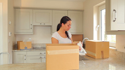 Couple unpacking after move Stock Video Footage