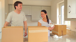 Couple unpacking after move Footage