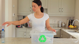 Woman putting plastic into recycling bin Footage