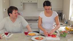 Woman preparing salad and sandwiches Footage