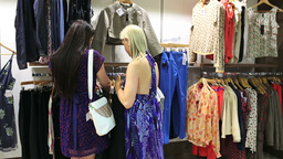 Women looking at dresses Stock Video Footage