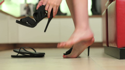 Woman trying on shoes Stock Video Footage