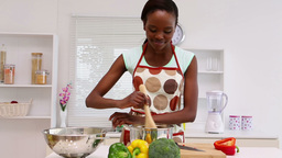 Woman is cooking in the kitchen Stock Video Footage