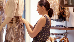 Woman dressing mannequin Footage