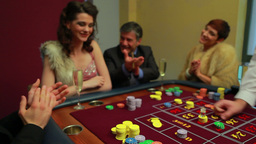 Woman wins at craps game Footage
