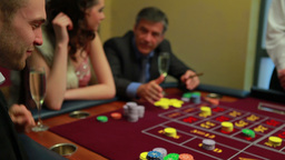 People placing bets at craps table Stock Video Footage