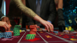 People placing their bets on roulette table Stock Video Footage