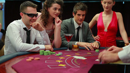 Man in sunglasses winning at blackjack Footage