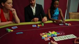 People placing their bets at poker game Stock Video Footage